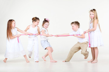 Four happy little girls and one boy  draw over pink rope
