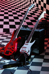 Two electric guitars and sound amplifying equipment