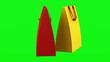 two red and yellow shopping bags loop rotate on green chromakey