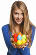 Smiling woman holding basket with Easter eggs