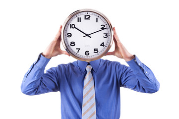Young businessman with analog clock over his face. Deadline