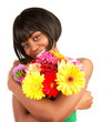Black woman with gerbera flowers