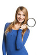 Happy smiling female holding magnifying glass