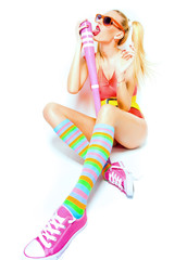 sexy baseball girl in colorful clothes posing glamorous