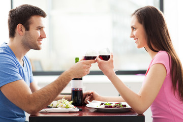 Couple having toast in restaurant