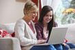 Mother and daughter on laptop - 50686329