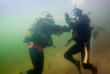 two Scuba divers training