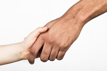 Handshake between white child and black man