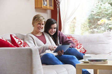 Mother and daughter on tablet computer