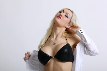 partly nude young blond woman with bra