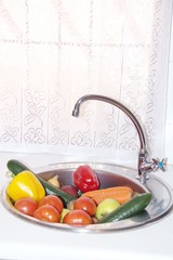Fresh colourful vegetables in a sink