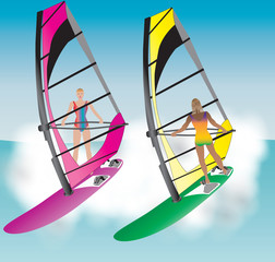 Two Pretty Women Windsurfing down a wave