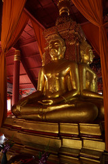 The three sitting gold buddha in chapel