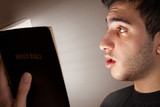 Man Reading Bible in Amazement
