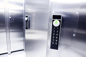Closeup of a digital padlock in a modern locker room