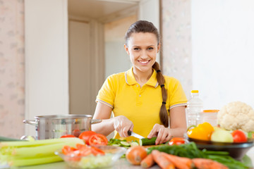 woman chopping  vegetables at  kitchen