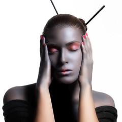 Beautiful Zen Woman. Creative High Fashion Makeup.