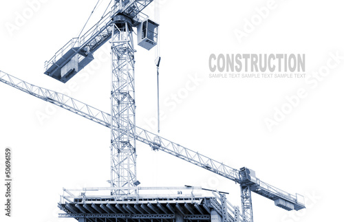 Construction cranes on white. Monochrome industrial background.