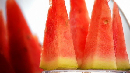 Fresh sliced melonwater gyrating in loop. Close up.