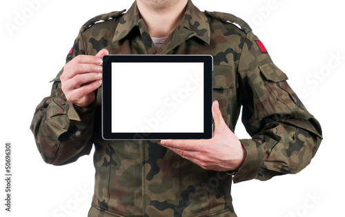 soldier holding blank digital tablet. clipping path for the scre