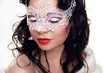 Portrait of beautiful girl in Carnival mask on face isolated on