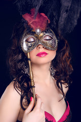 Masquerade. Sexy woman with Carnival mask on face