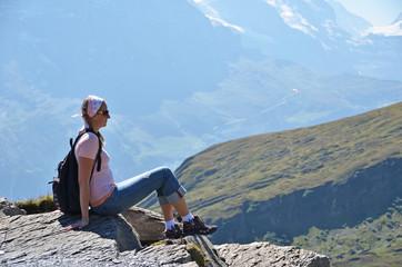 Traveler on the top of a rock. Jungfrau region, Switzerland