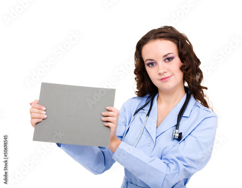 Smiling medical doctor holding blank clipboard