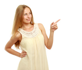 A young woman pointing at a copyspace