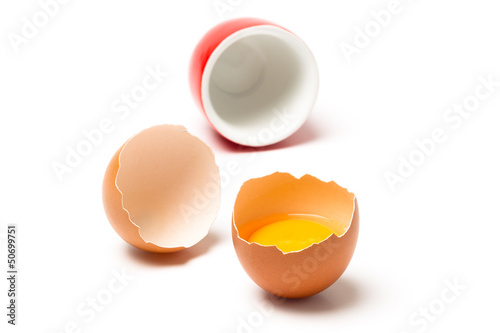 Egg and cup isolated on white background