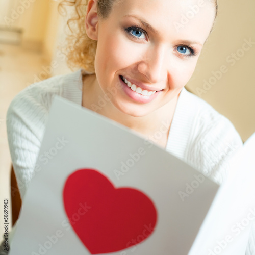 Cheerful smiling woman, reading valentine card