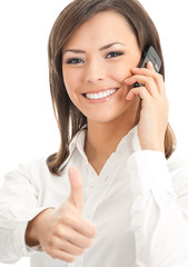 Happy smiling successful businesswoman with cell phone and thumb