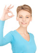 young woman showing ok sign