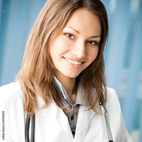 Cheerful female doctor at office