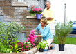 Gardening senior couple.