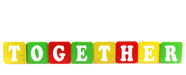 together - isolated text in wooden building blocks