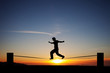 silhouette of slackliner in sunset