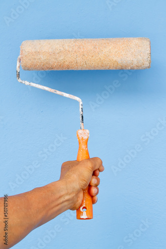 Holding Painting roller in hand