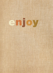 Enjoy word on linen background