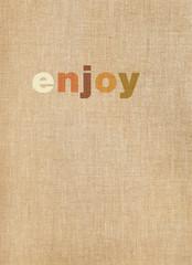 Enjoy word on linen background