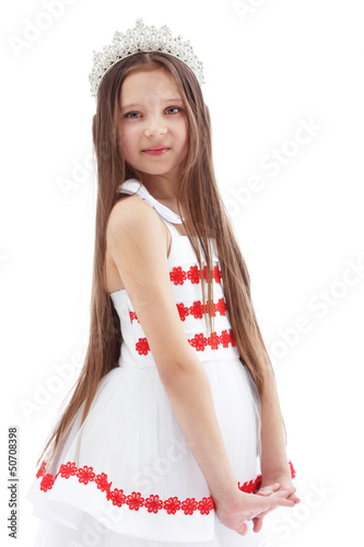 Smiling lovely girl posing in crown