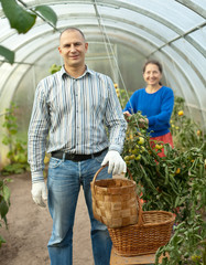 Man and woman in hothouse