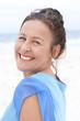 Portrait smiling mature woman blue blouse