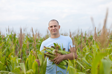 Happy  farmer in field of corn