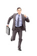 Full length portrait of a businessman running with a briefcase a