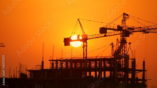 Construction site at sunset, time lapse