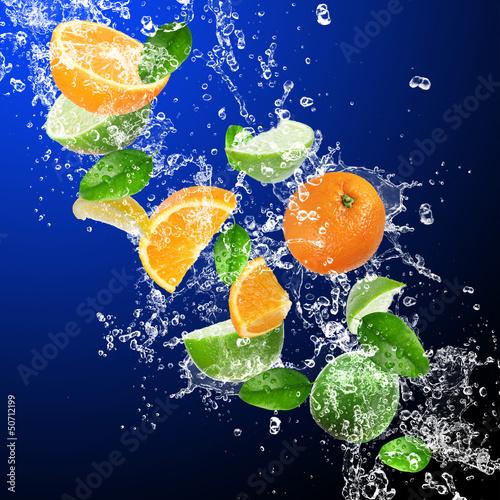 Foto op Canvas Opspattend water Tropical fruits in water splash