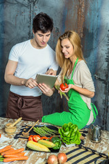 Young Couple Surfing the Web in the Kitchen