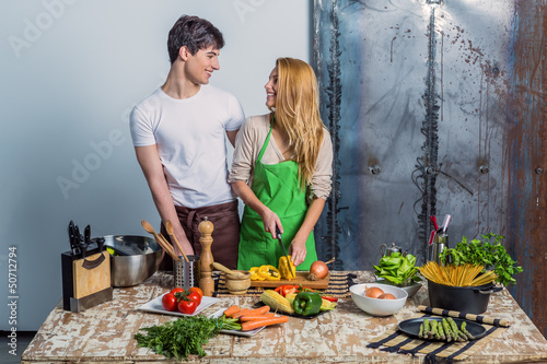 Young Loving Couple in the Kitchen