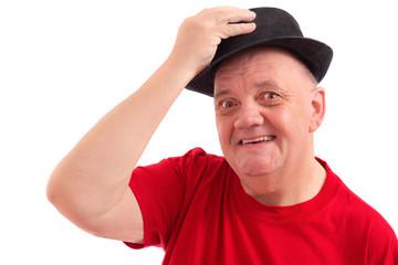 homme soulevant le chapeau pour saluer sur fond blanc